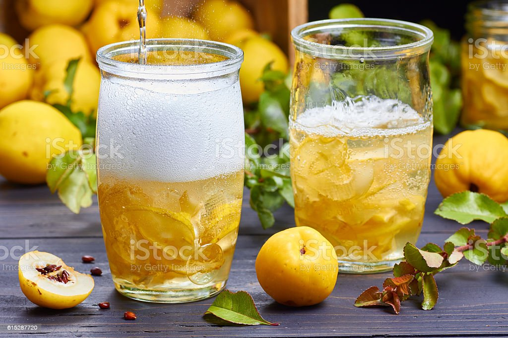 carbonated drink with syrup of japanese quince on fresh  fruits stock photo