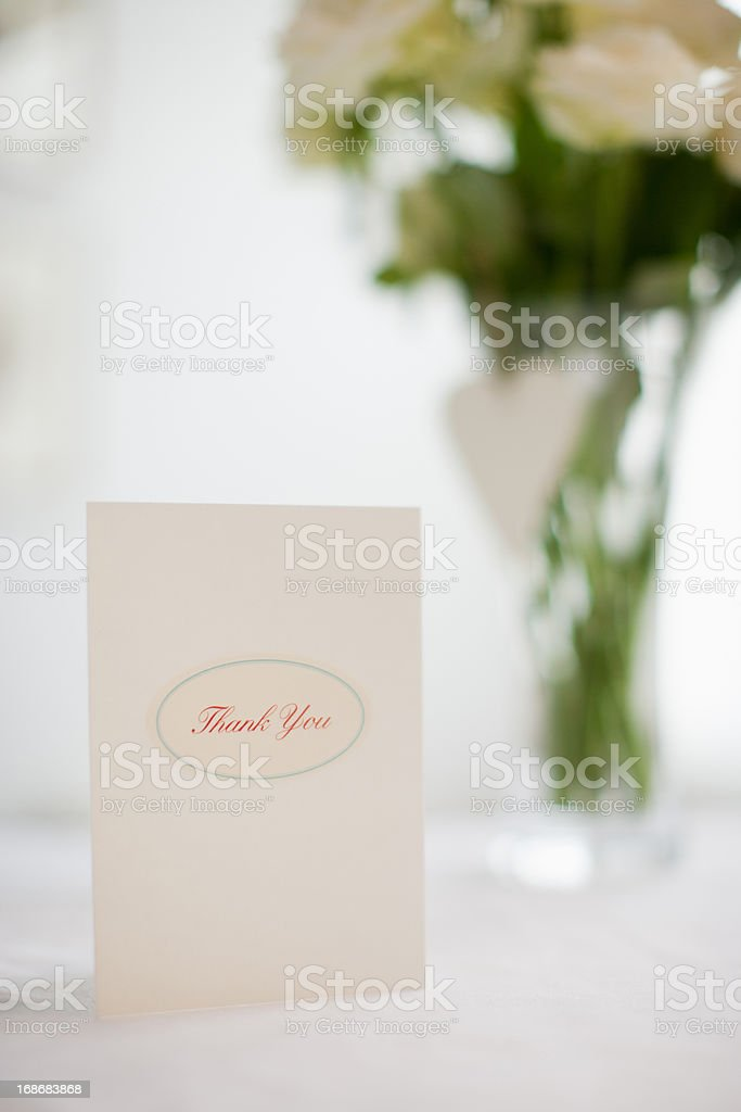 Card and bouquet of white roses stock photo