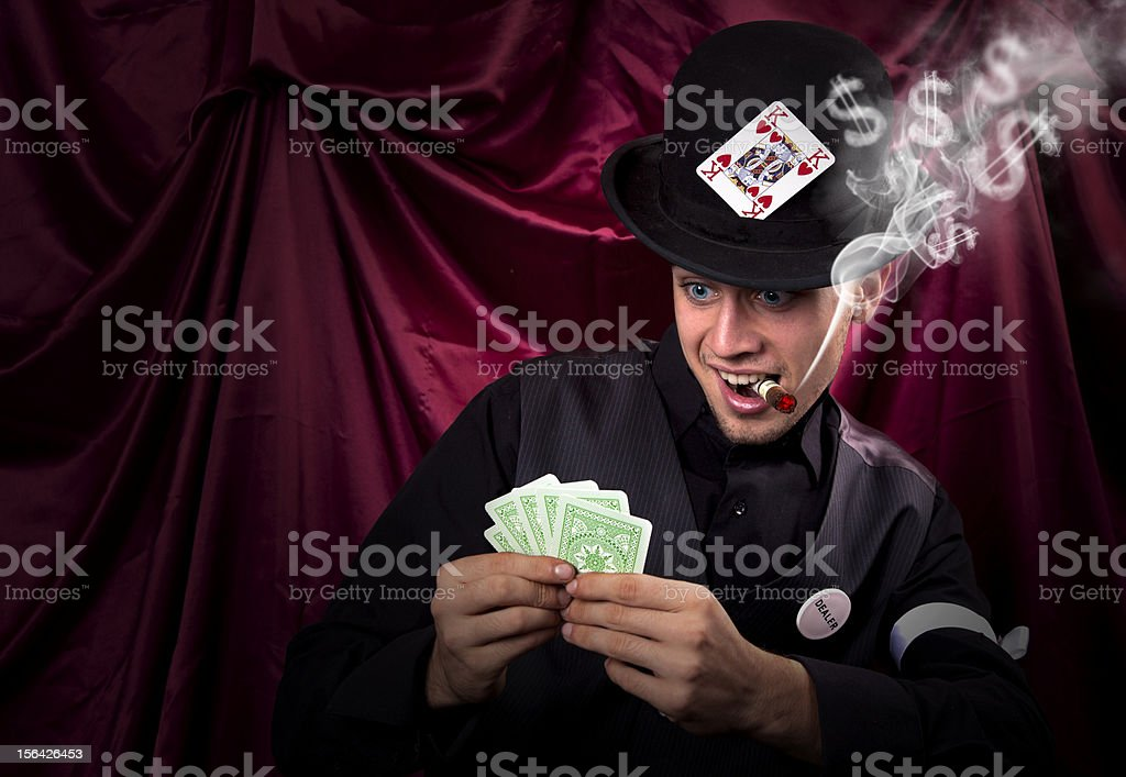 Card dealer with very good hand royalty-free stock photo