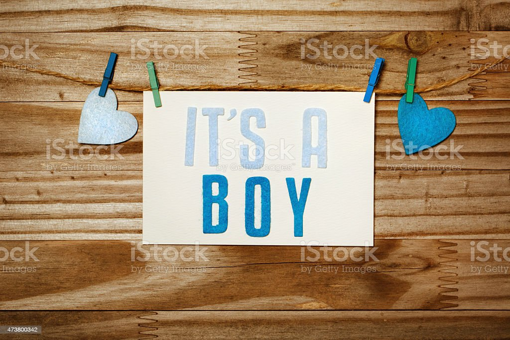 ITS A BOY card hanging with clothespins stock photo