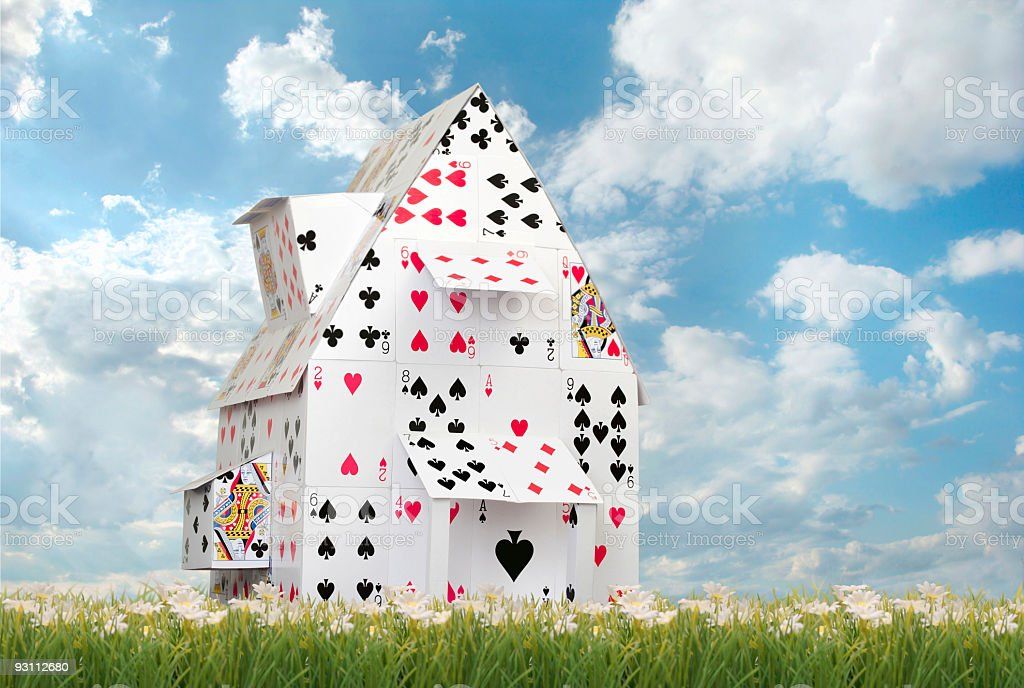 Card House Against Blue Skies stock photo