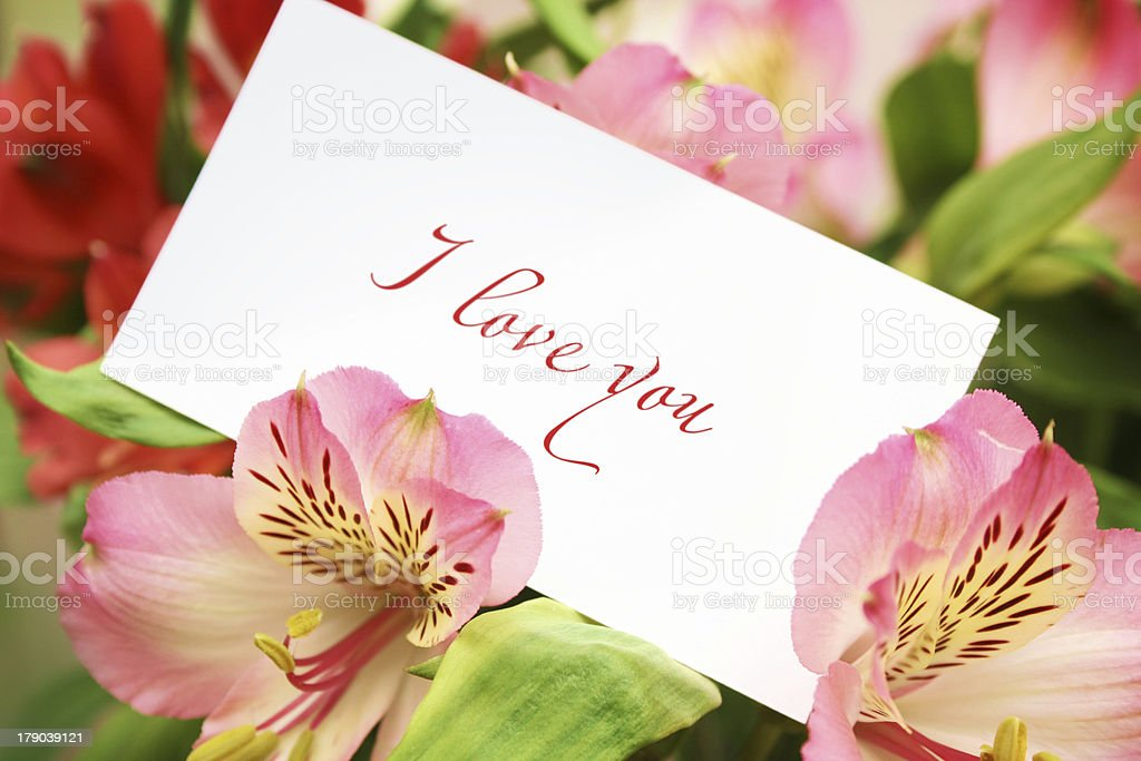 Card in flowers with love words royalty-free stock photo