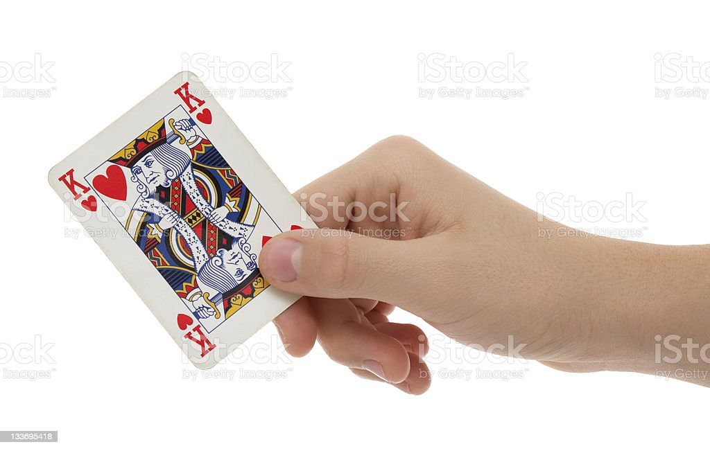 Card king of hearts in hand stock photo