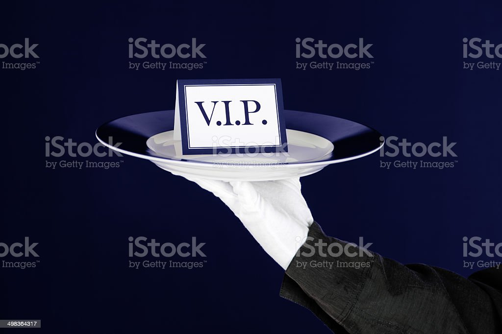 VIP Card On Platter Held By Waiter royalty-free stock photo