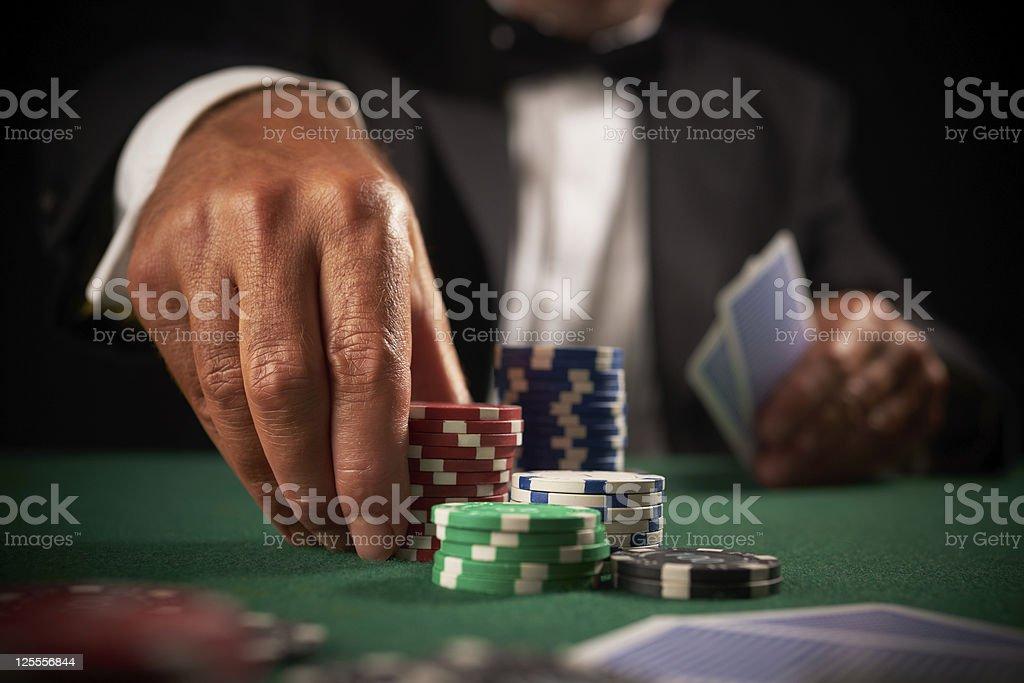 card player gambling in casino stock photo