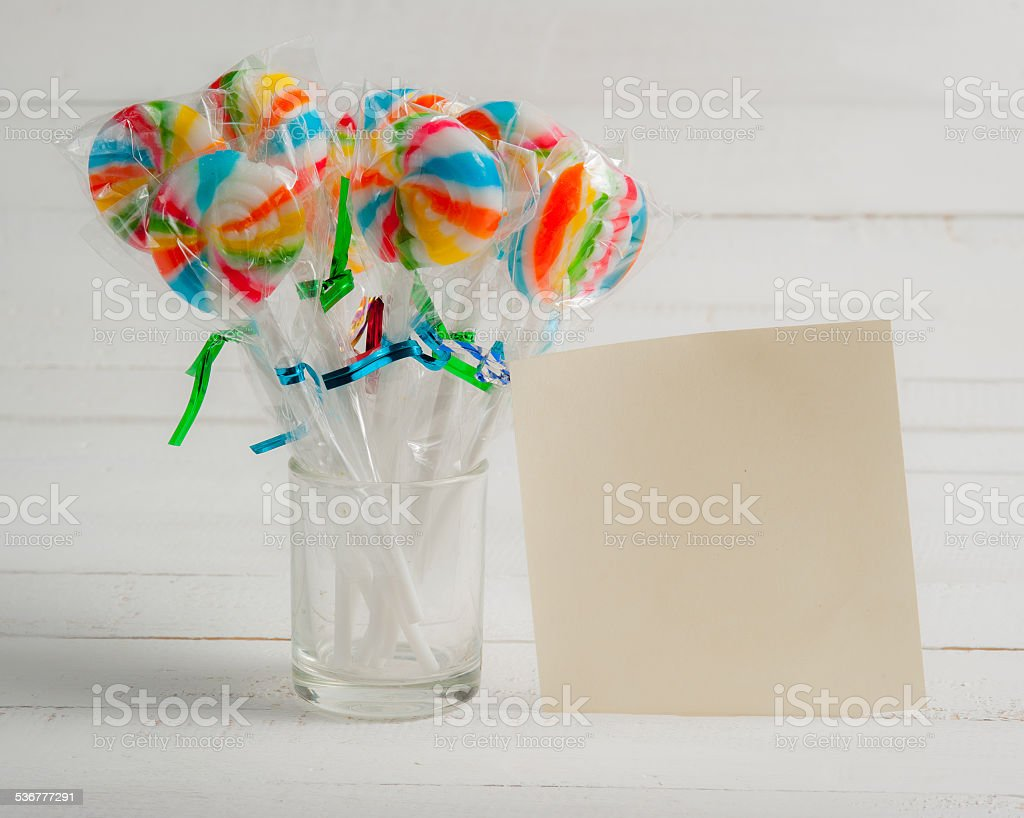 card with lollipops and on black leather stock photo