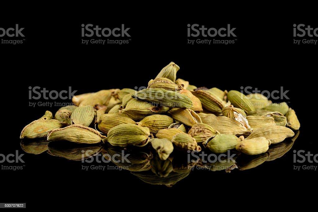 Cardamom pods on a black background stock photo