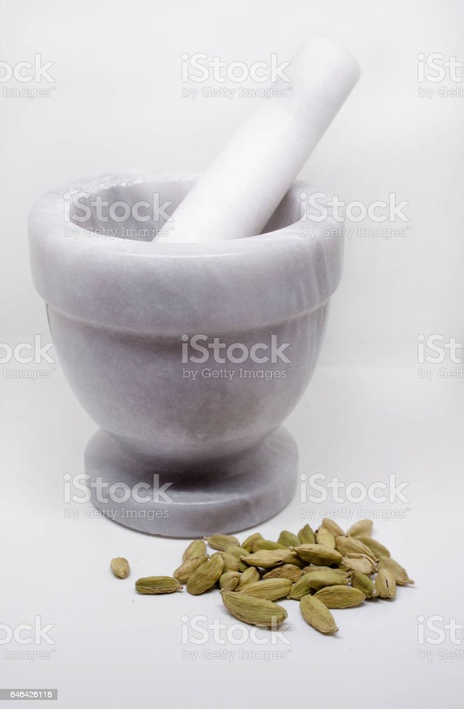 cardamom seeds and marble mortar stock photo