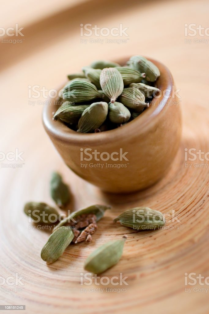 Cardamom Seeds in Bowl stock photo