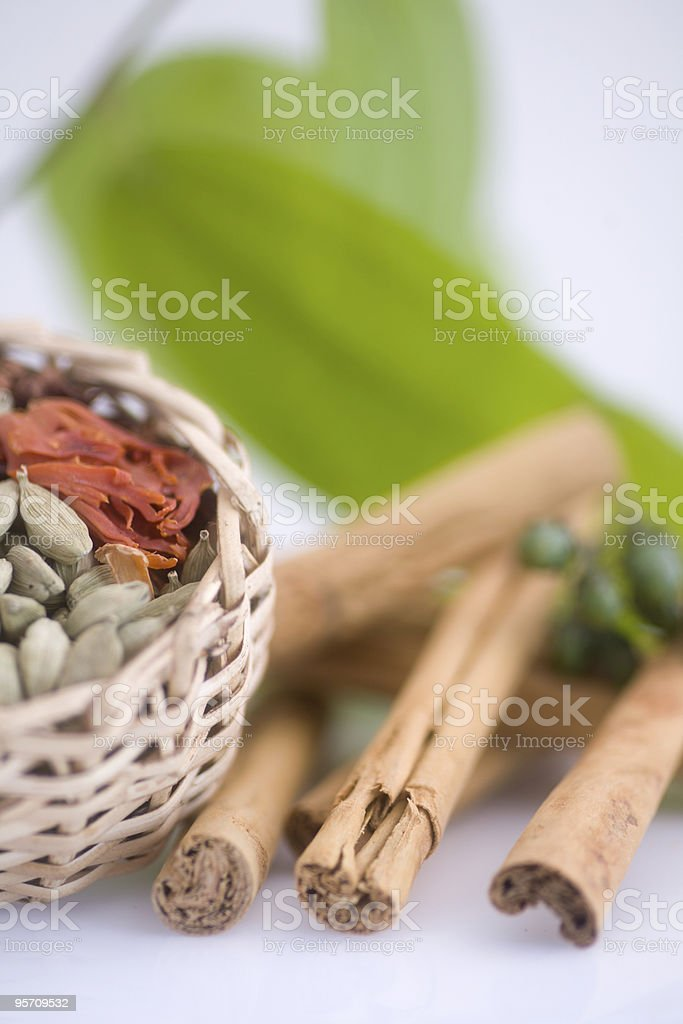 cardamon, cinnamon and mace spice ingredients royalty-free stock photo