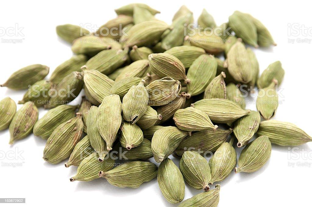 Cardamon seeds isolated on white royalty-free stock photo