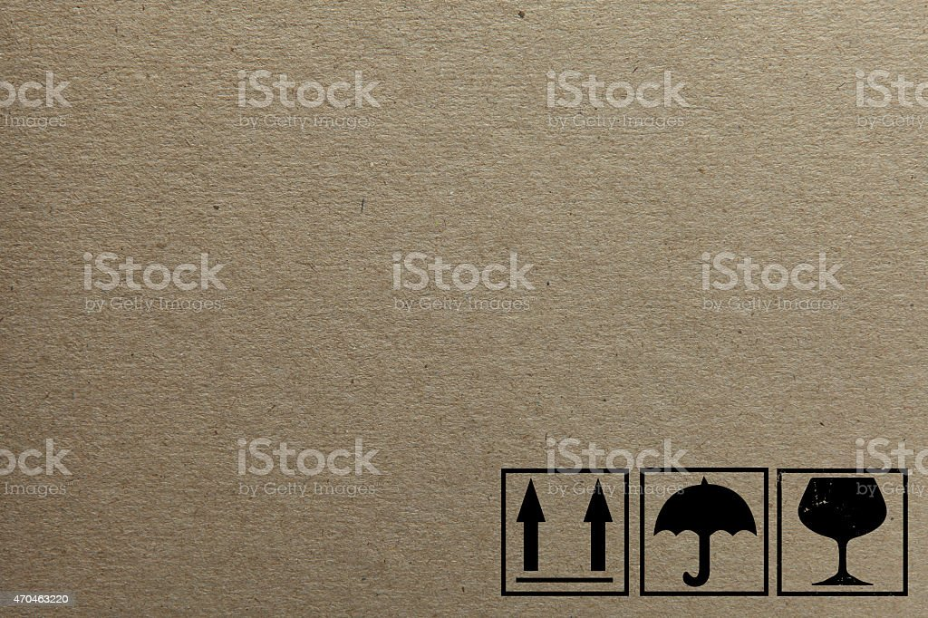 Cardboard background with fragile and this side up icons stock photo