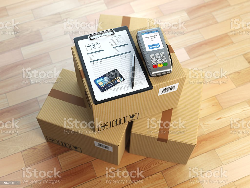 Cardboard box, clipboard with receiving form and pos terminal stock photo
