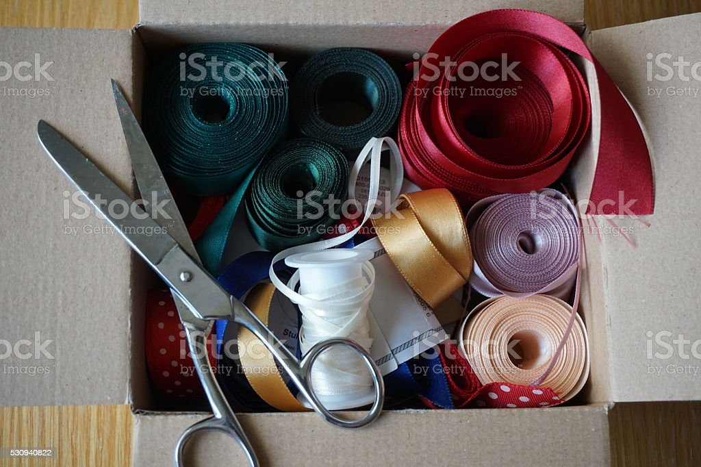 Cardboard box full of equipment for sewing, and decorating stock photo