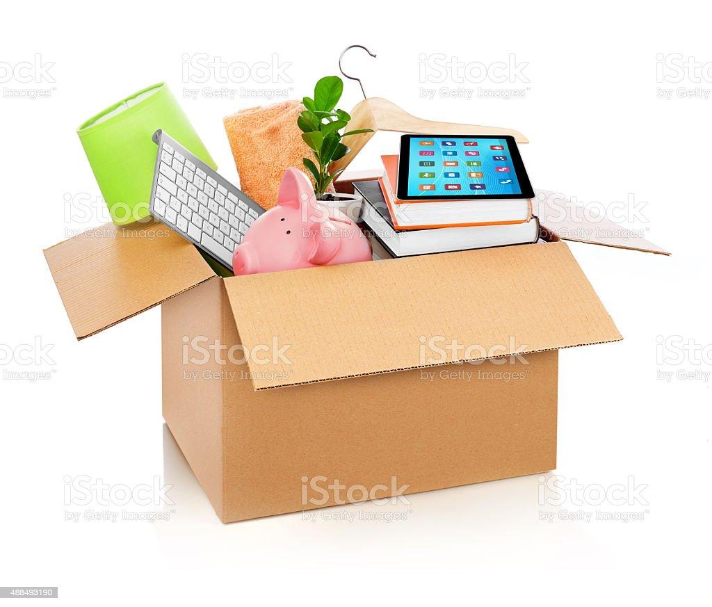 Cardboard box full with household stuff stock photo