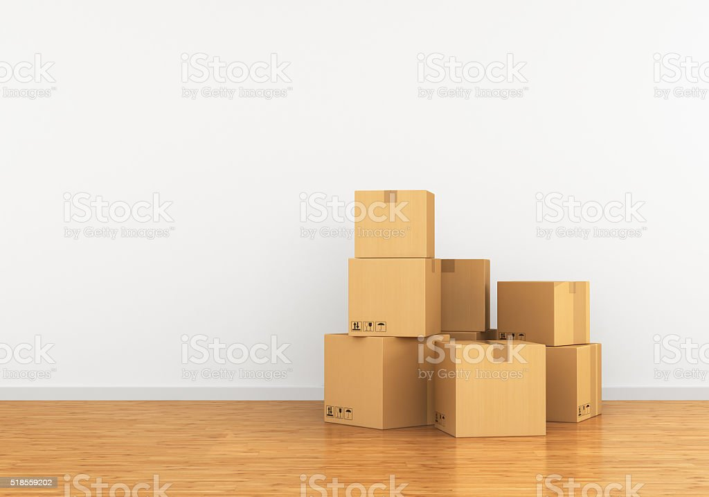 Cardboard box in an empty apartment. stock photo