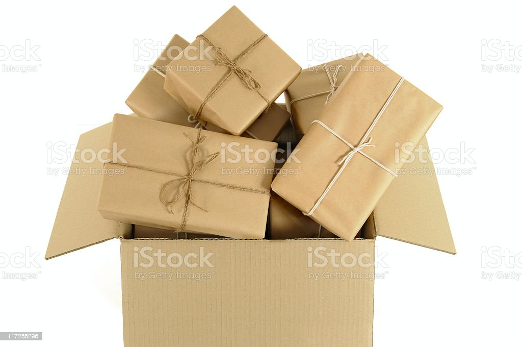 Cardboard box overflowing with wrapped packages royalty-free stock photo