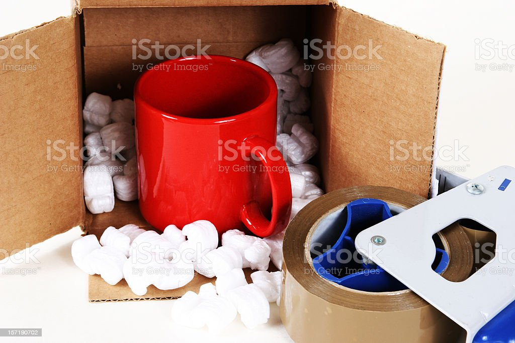 Cardboard box, package with packing peanuts. Tape, coffee cup. royalty-free stock photo
