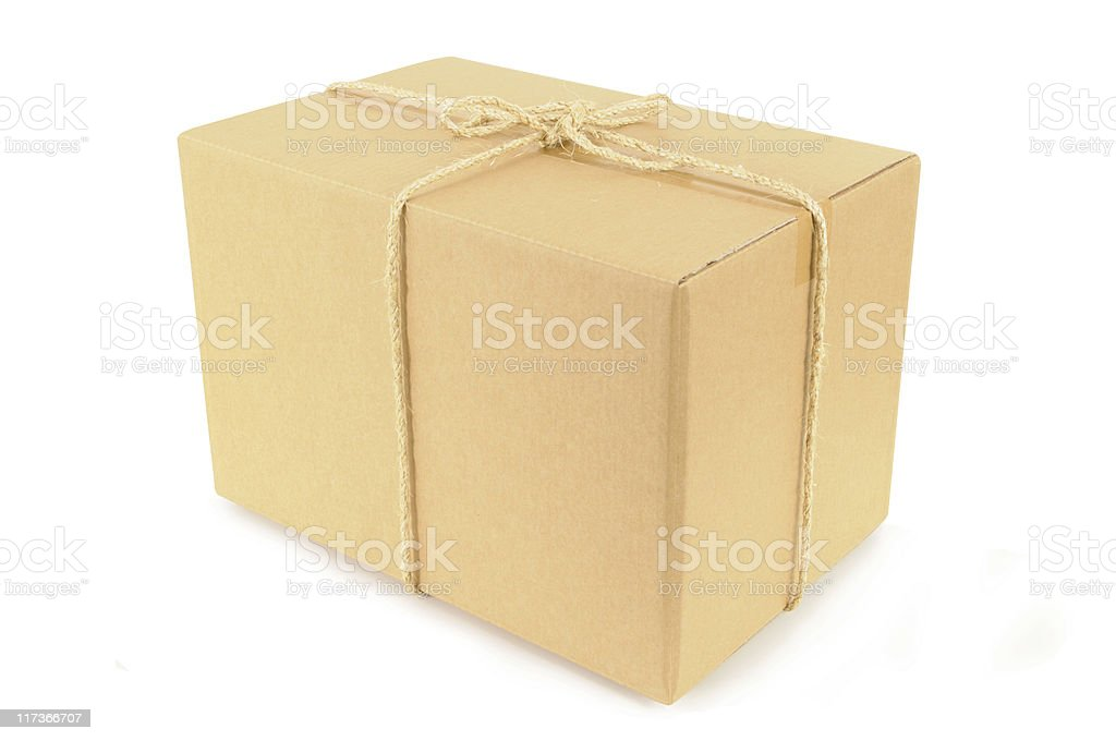 Cardboard box tied with rope royalty-free stock photo