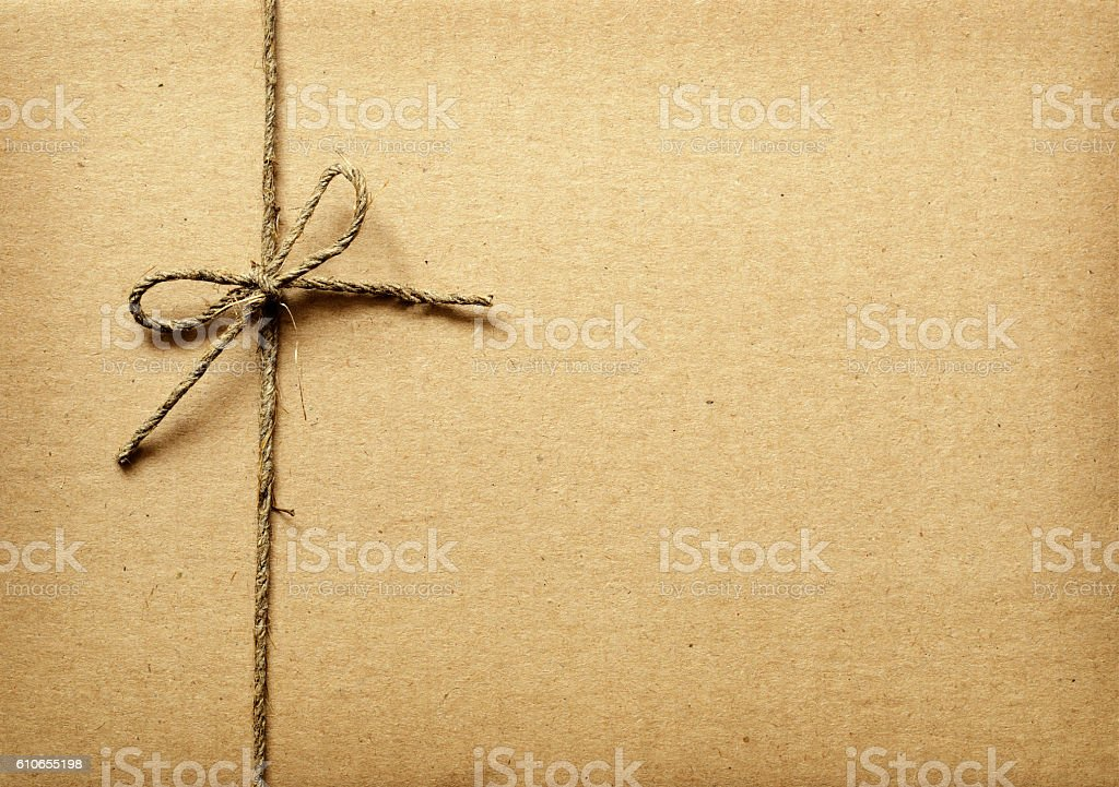Cardboard box tied with rope stock photo