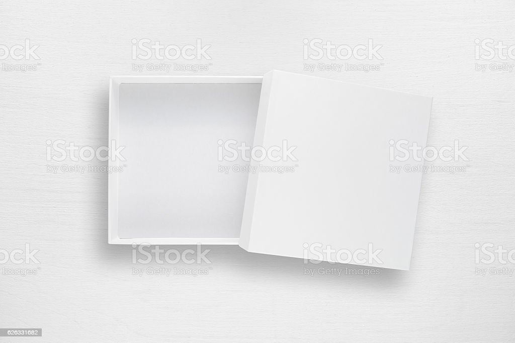 Cardboard box with cover on white table stock photo