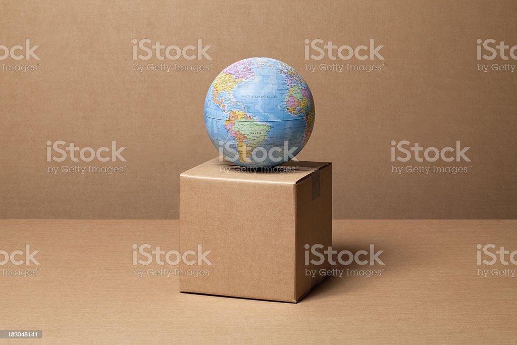 Cardboard box with globe royalty-free stock photo