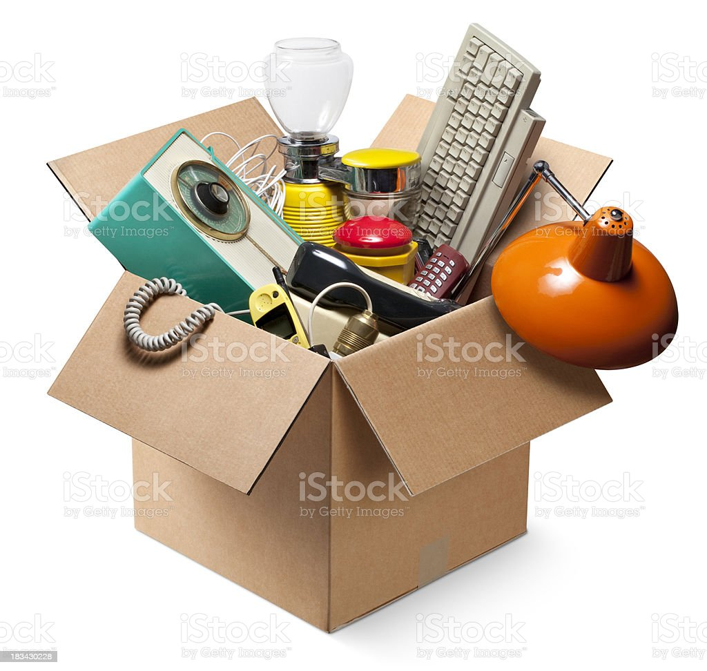 Cardboard box with old electrical appliances stock photo