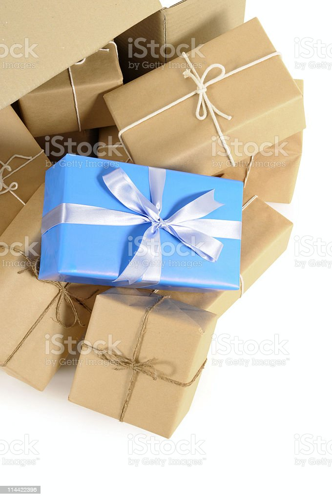 Cardboard box with wrapped packages stock photo