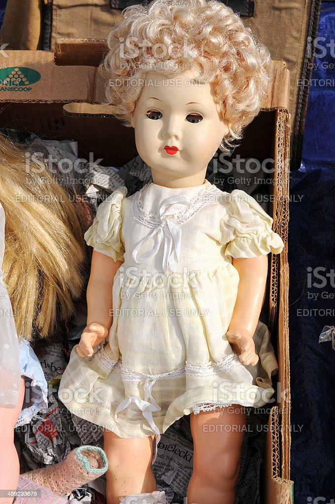 cardboard boxes on flea market with old baby doll toy royalty-free stock photo