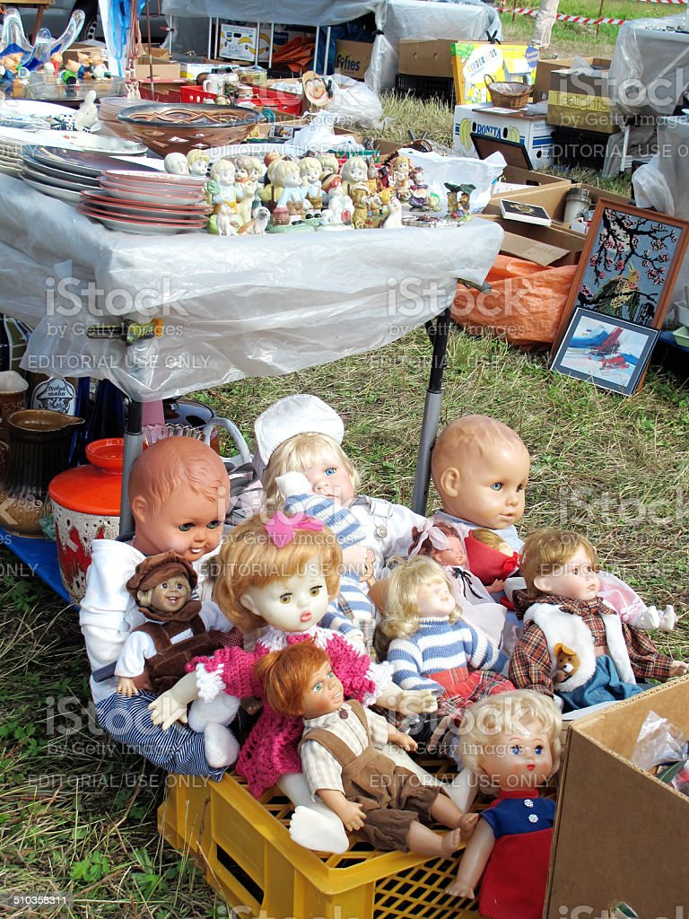 cardboard boxes on flea market with old baby doll toys stock photo