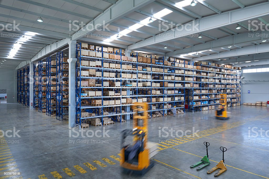Cardboard boxes on shelves in warehouse stock photo