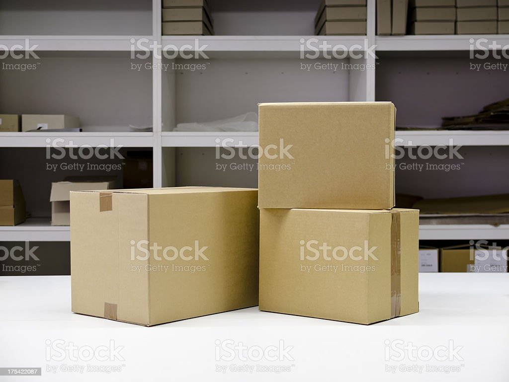 Cardboard boxes on the table royalty-free stock photo