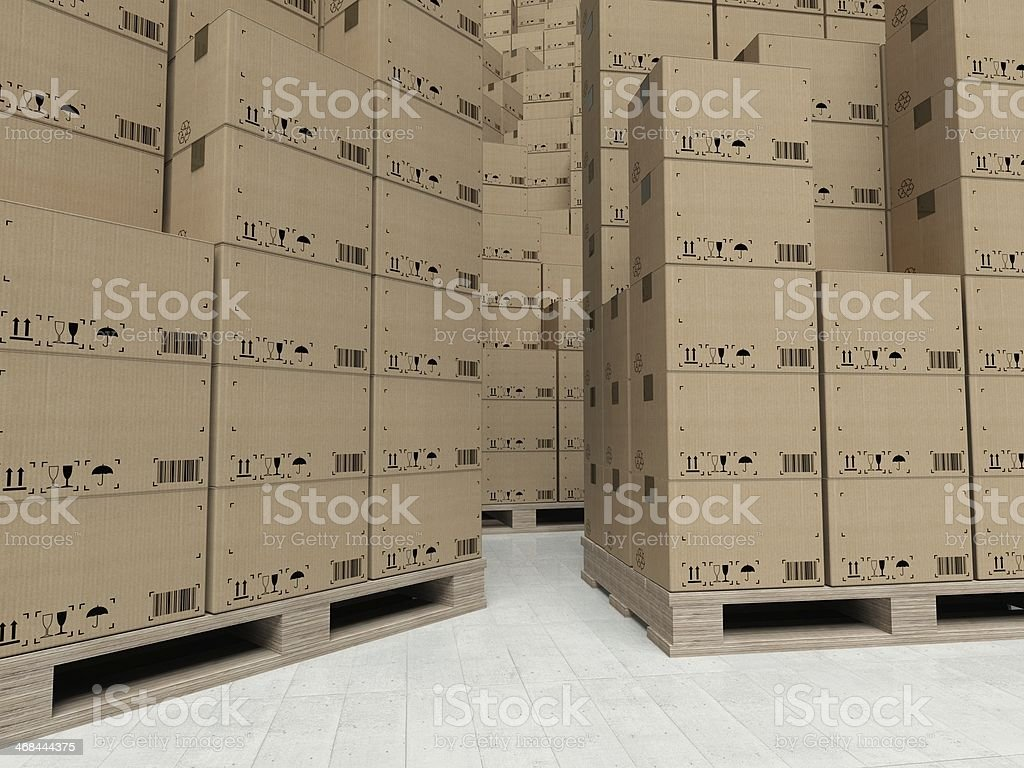 Cardboard boxes on wooden paletts, inside the warehouse royalty-free stock photo