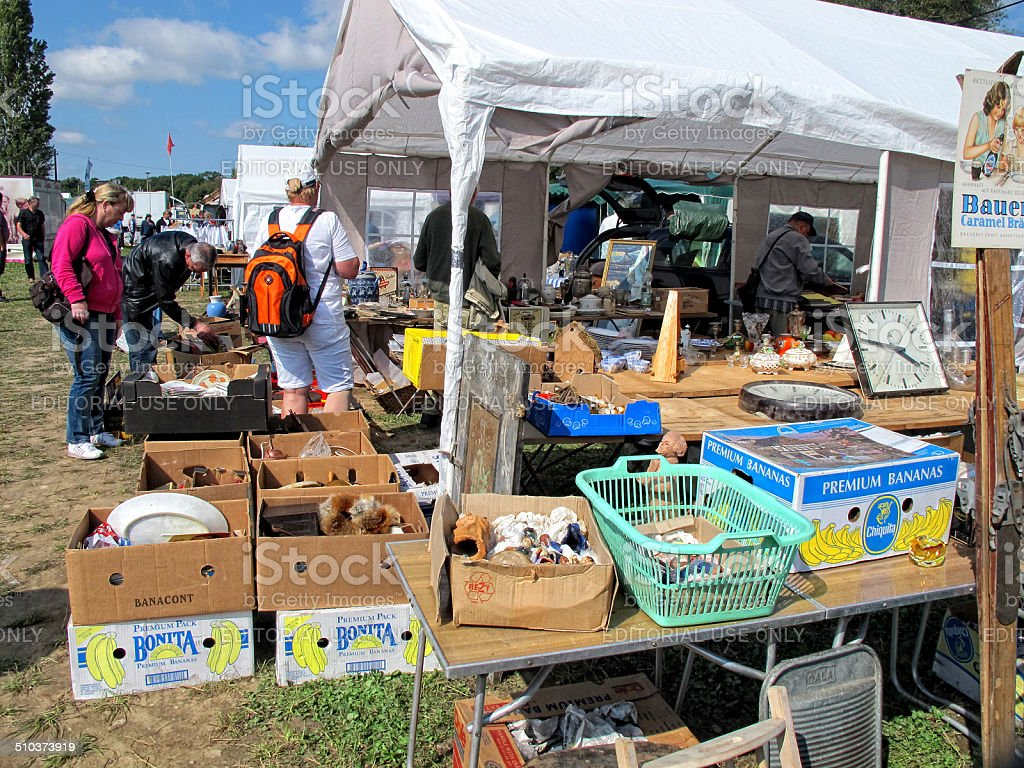 Cardboard boxes with items for sale at Flea Market stock photo