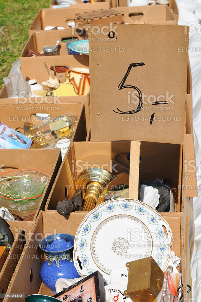 Cardboard boxes with vase and dishware at Flea Market royalty-free stock photo