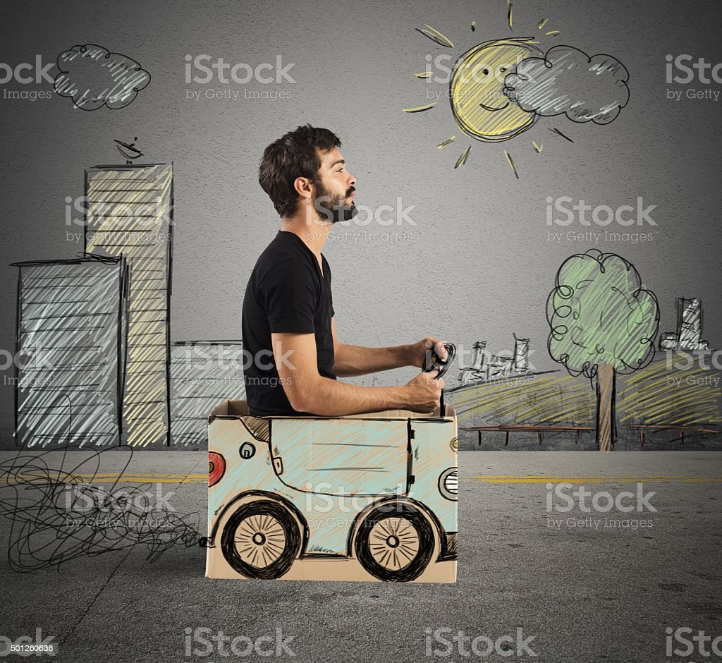 Cardboard car in drawing city stock photo