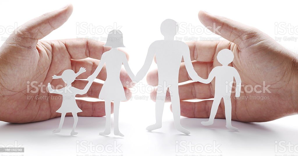 Cardboard figures of the family on a white background. royalty-free stock photo