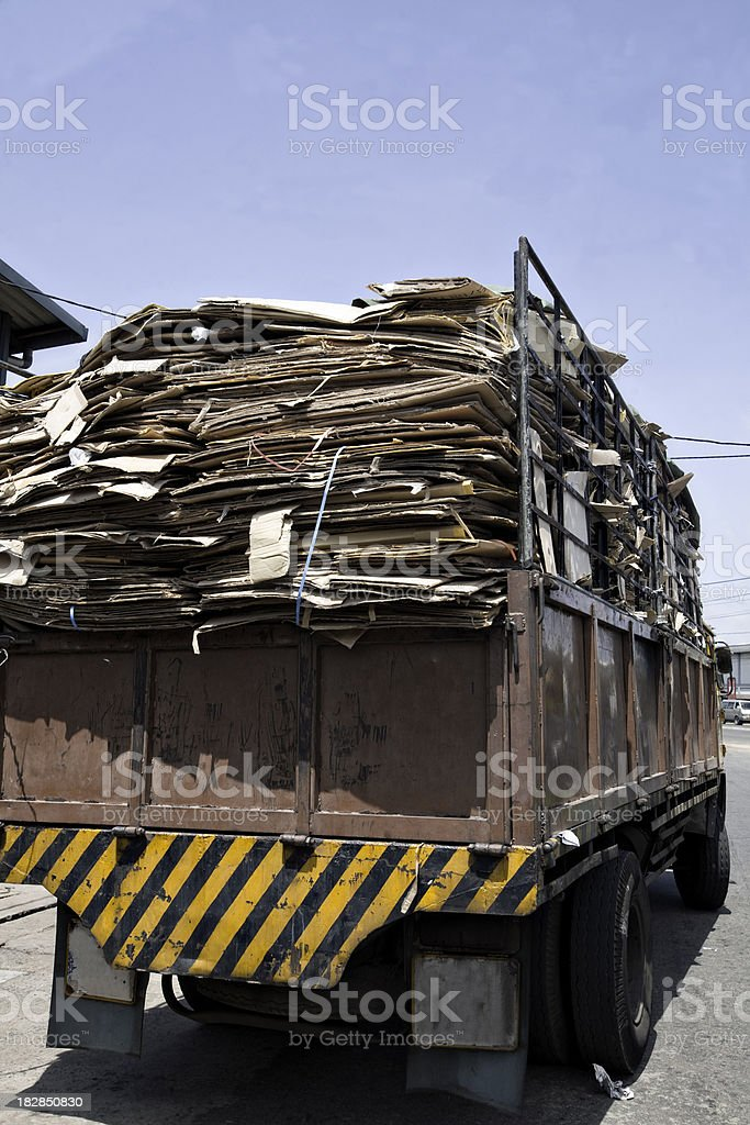 cardboard for recycling loaded on truck stock photo