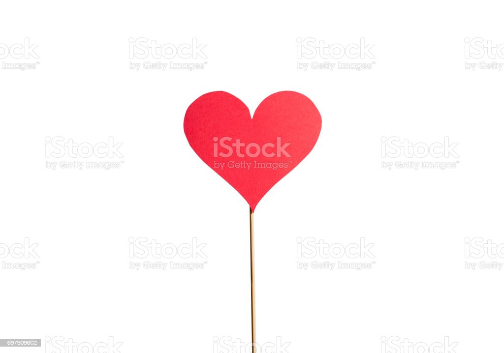 Cardboard heart on a wooden stick isolated on white background. Classic love symbol cut from paper. Red sign with papery texture. Simple design element for valentine's, women's or mother's day card. stock photo