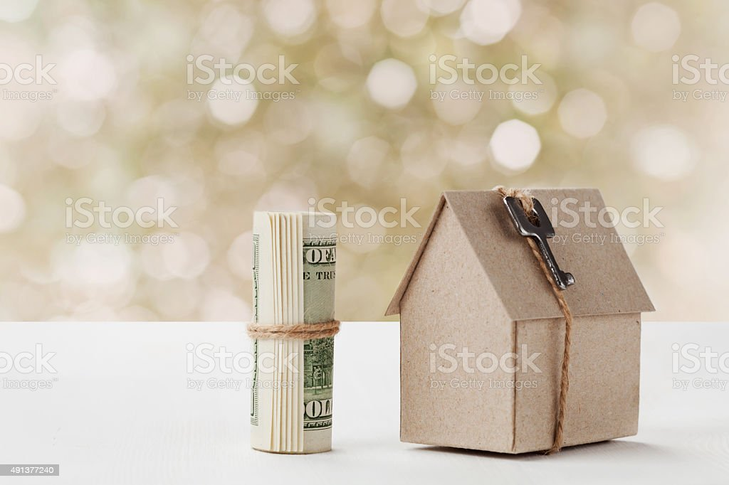 Cardboard house, building, loan, cost of buying new home concept stock photo