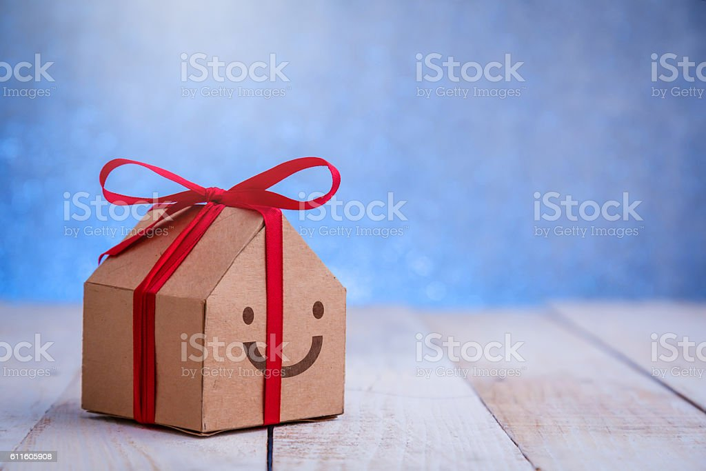 cardboard house wrap with red ribbon stock photo