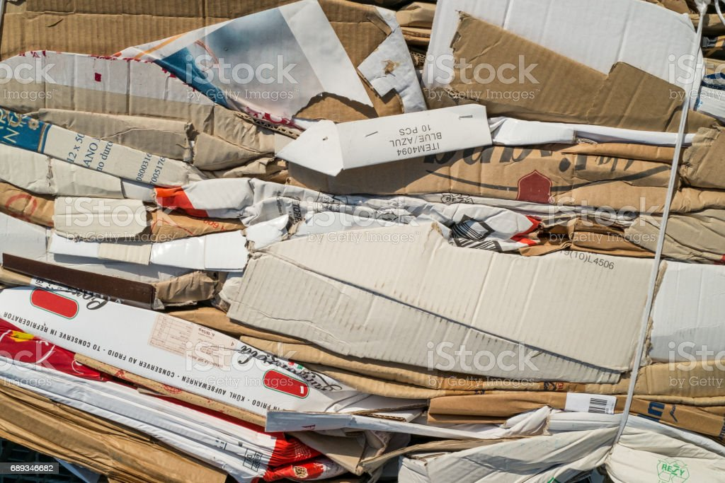 Cardboard in the recycling process stock photo