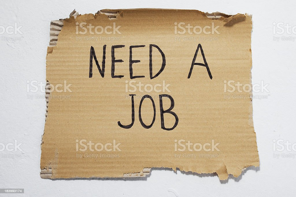 Cardboard that says need a job royalty-free stock photo