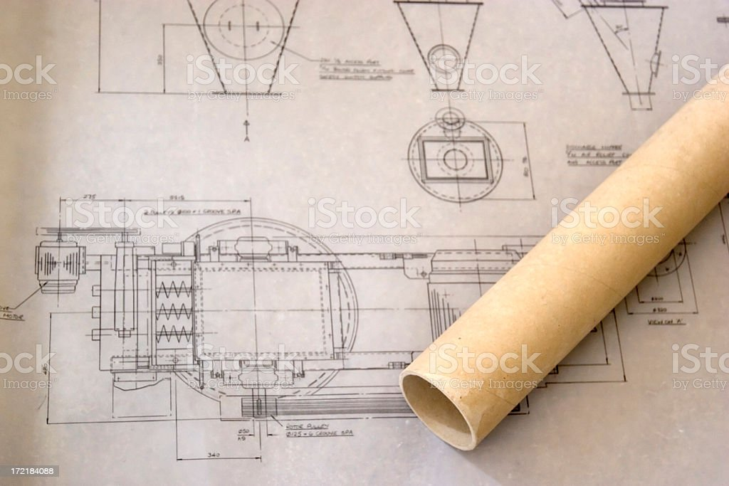 Cardboard tube on old architect's drawing stock photo