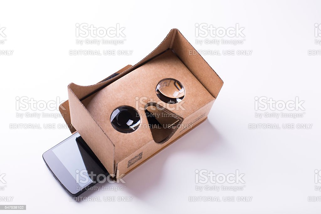 cardboard virtual reality headset and a smartphone by Google stock photo