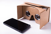 cardboard virtual reality headset and a smartphone by Google