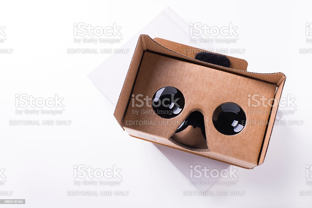 cardboard virtual reality headset over white book stock photo