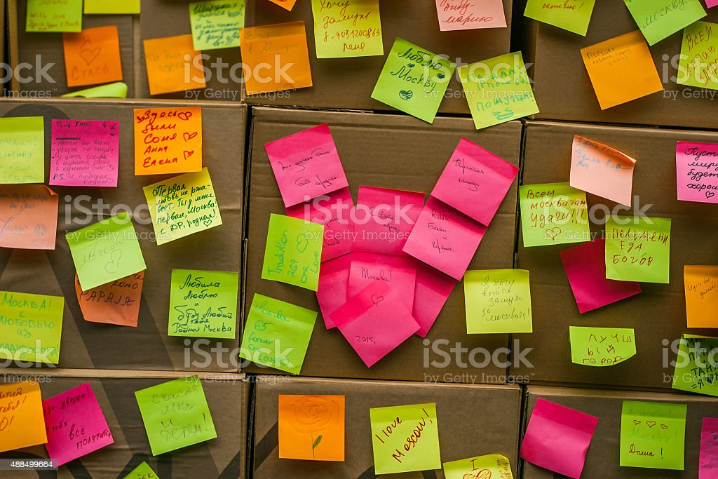 Cardboard wall with colorful stickers stock photo