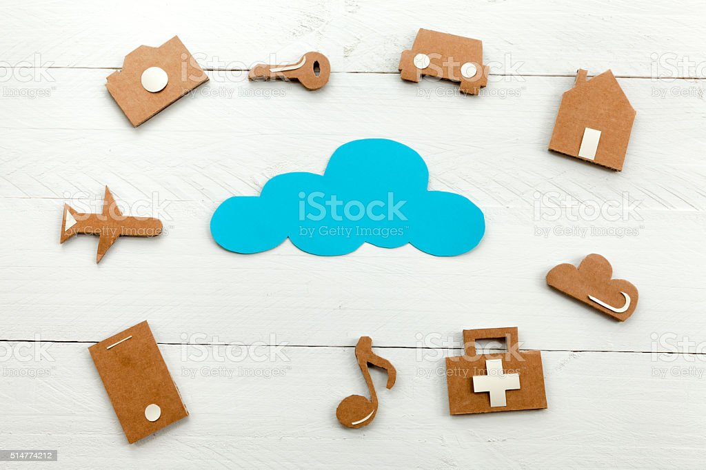 Cardboard web icons  and blue cloud on blue background stock photo