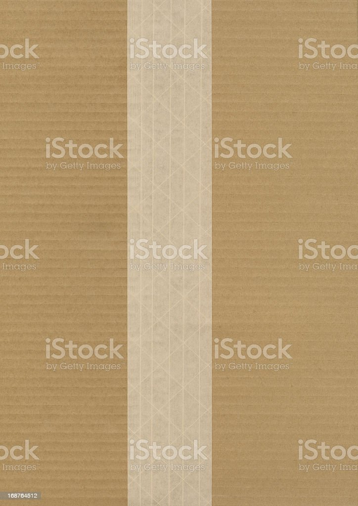 Cardboard With Fiber Reinforced Brown Shipping Tape royalty-free stock photo